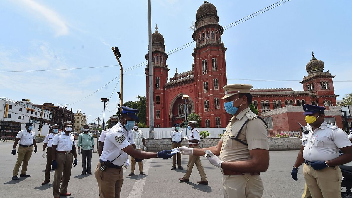 Chennai: Assistant Commissioner of Police (ACP), Traffic, Ravichandran distributes vitamin tablets to his colleagues in a bid to improve immunity against COVID-19 outbreak during the nationwide lockdown, in Chennai, Wednesday, April 29, 2020.