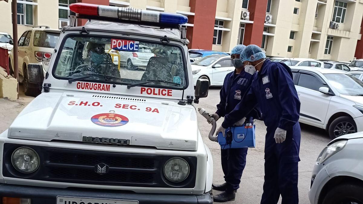 Droom Health team applying its Germ-Shield anti-microbial coating to Gurugram police vehicles.