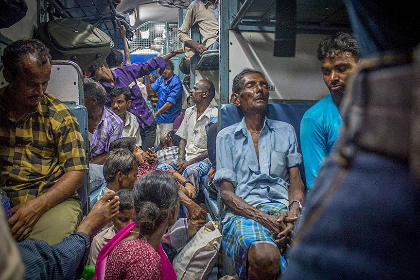 Exhausted migrant labourers who shuttle weekly between Anantapur in Andhra Pradesh and Kochi in Kerala.