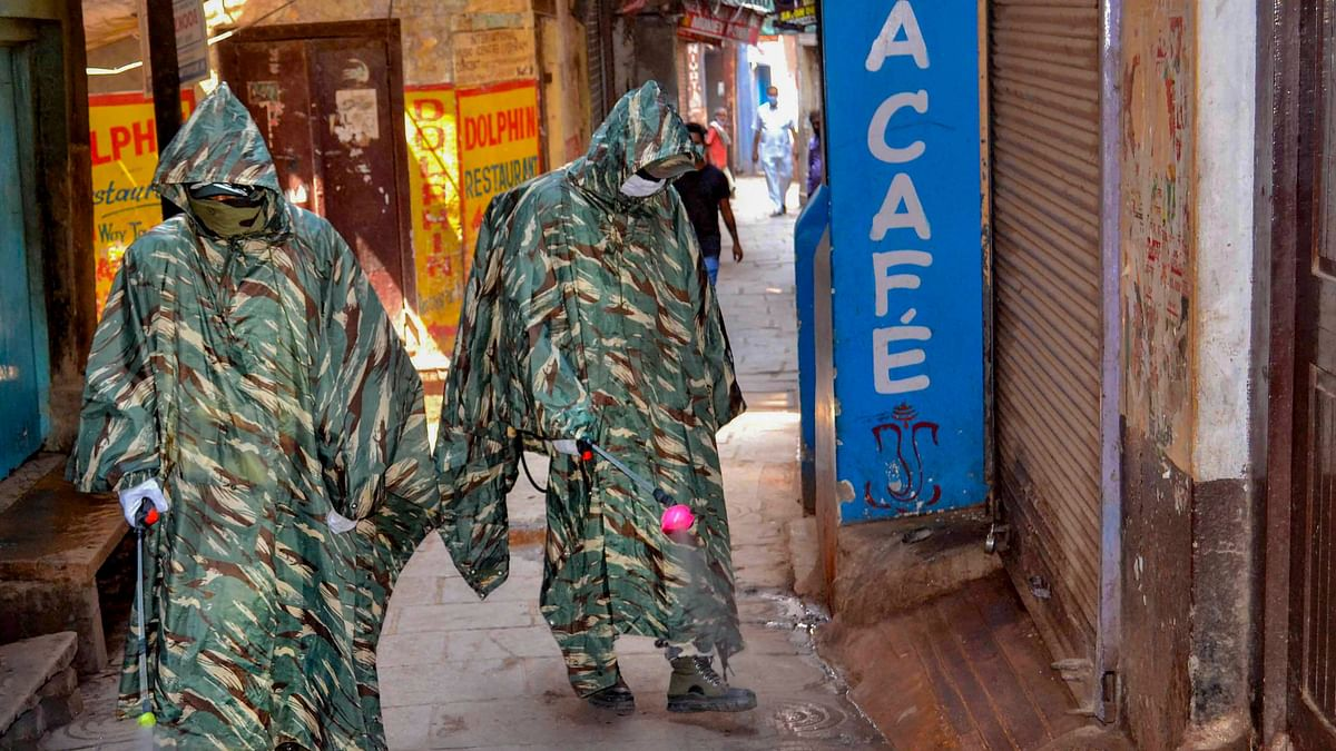 CRPF personnel wearing protective outfits sanitize a street near Dasaswamedh Ghat, Varanasi. Image used for representational purpose only.