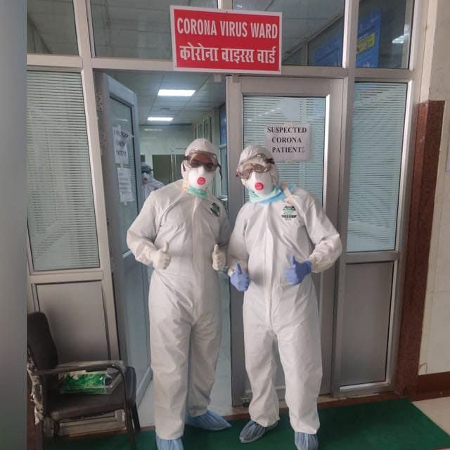 Doctors posing outside the coronavirus ward at KGMU hospital.