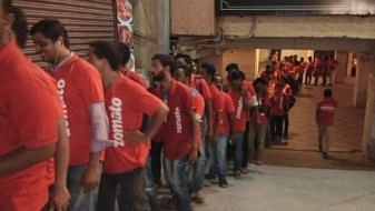 Zomato delivery executives line up.