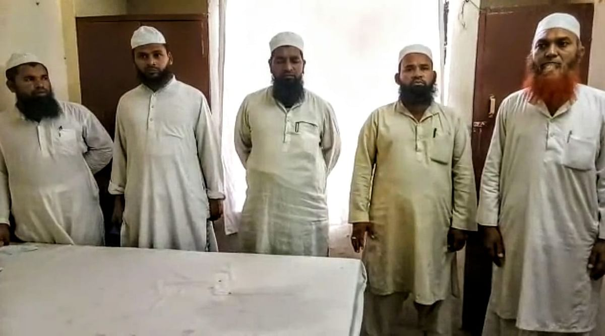While the Jamaat has five women, they also have their husbands, five men. Second from the right is Rizwana's husband Mohammad Rafi who has been trying to get his wife to a hospital since May 9.