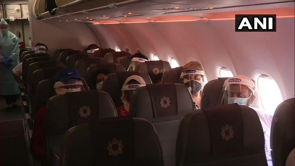 Passengers seated on a Vistara flight.