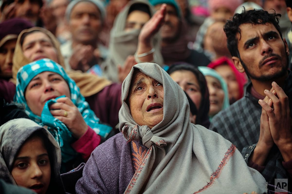 Kashmiri Muslim devotees offer prayer outside the shrine of Sufi saint Sheikh Syed Abdul Qadir Jeelani in Srinagar.