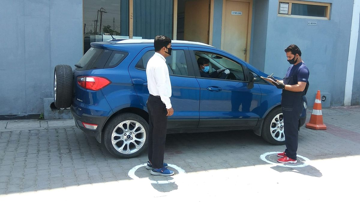 Social distancing norms at car service centres, like this one at Ford, will be the new normal.