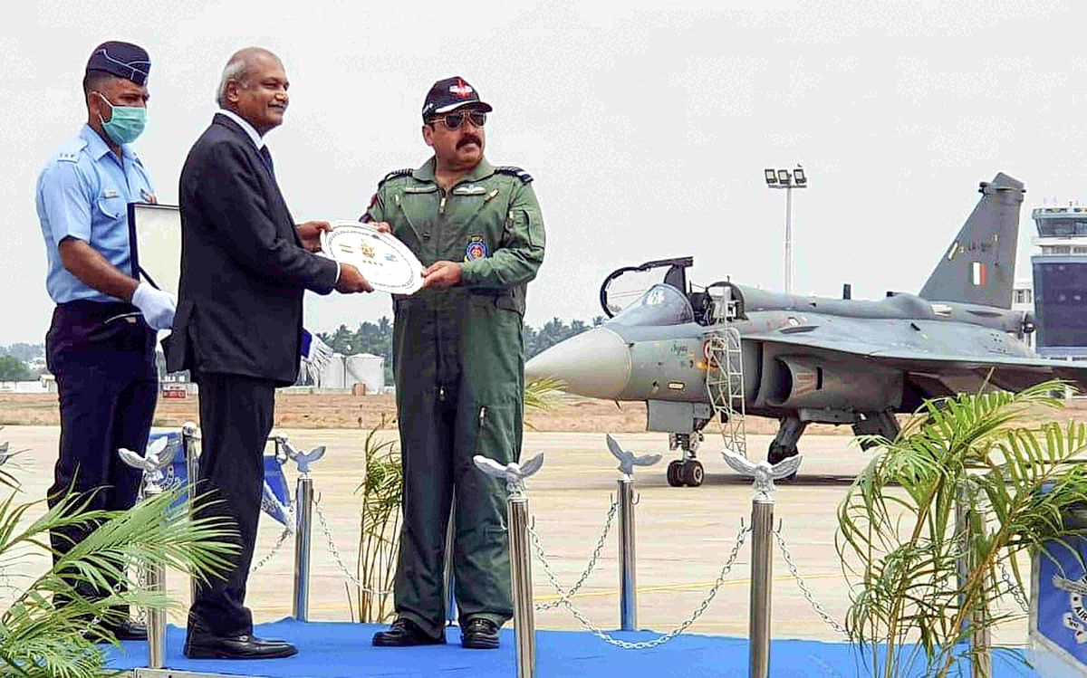 IAF chief RKS Bhadauria receives the first FOC standard LCA from HAL chairperson R Madhavan during a function held at Air Force Station in Sulur of Coimbatore district.