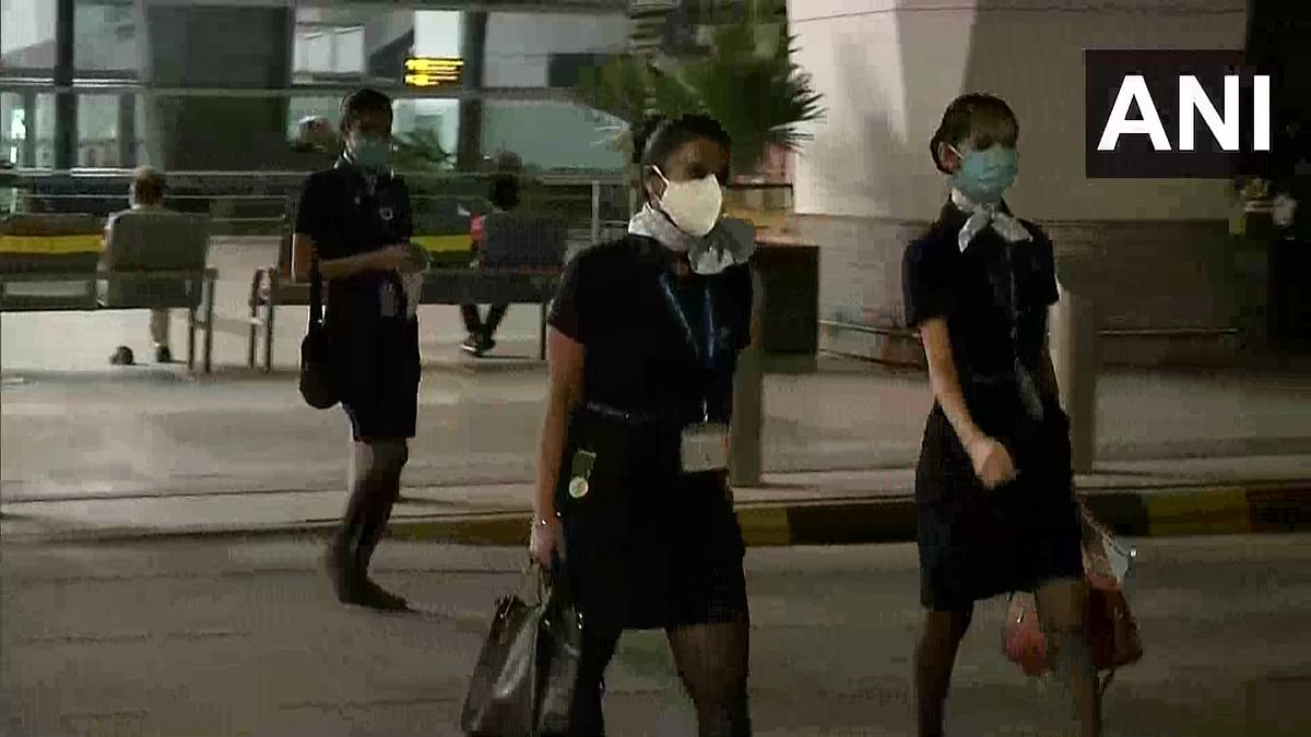 Indigo cabin crew arriving at the Delhi airport for an early morning flight.