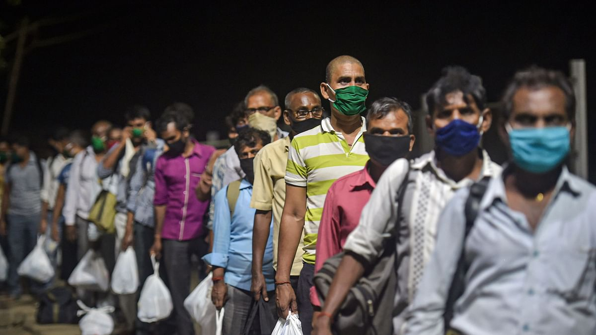 Migrants from various northern states of India wait to board a special train for Gorakhpur, during the ongoing COVID-19 lockdown, in Bhiwandi, Saturday, May 2, 2020.