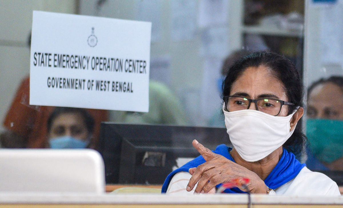 West Bengal CM Mamata Banerjee, wearing a mask, monitors the movement of cyclone Amphan from the control room ahead of its landfall, Tuesday.