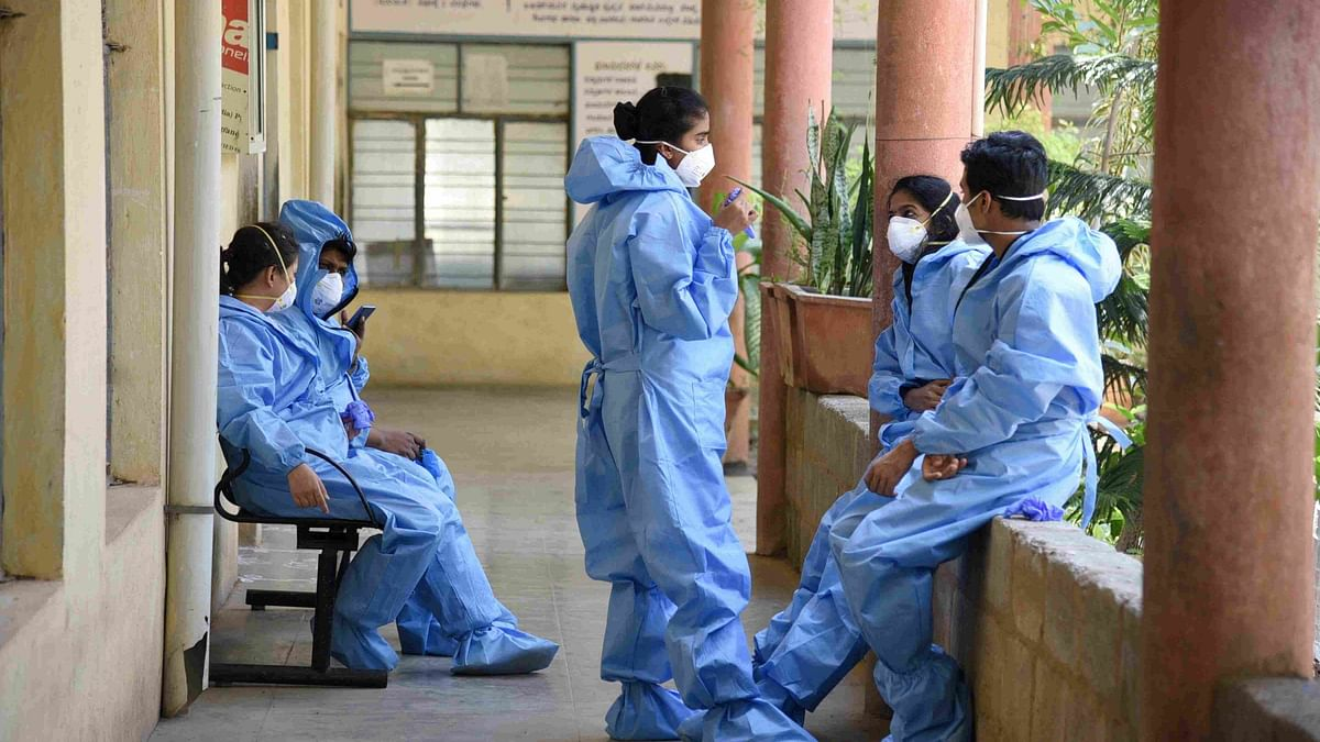 Coronavirus News Live Updates: Medics wearing protective suits are seen at a hospital in Bengaluru.