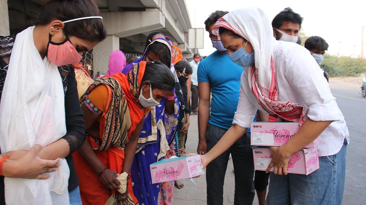 Swara Bhasker distributes footwear to migrants.