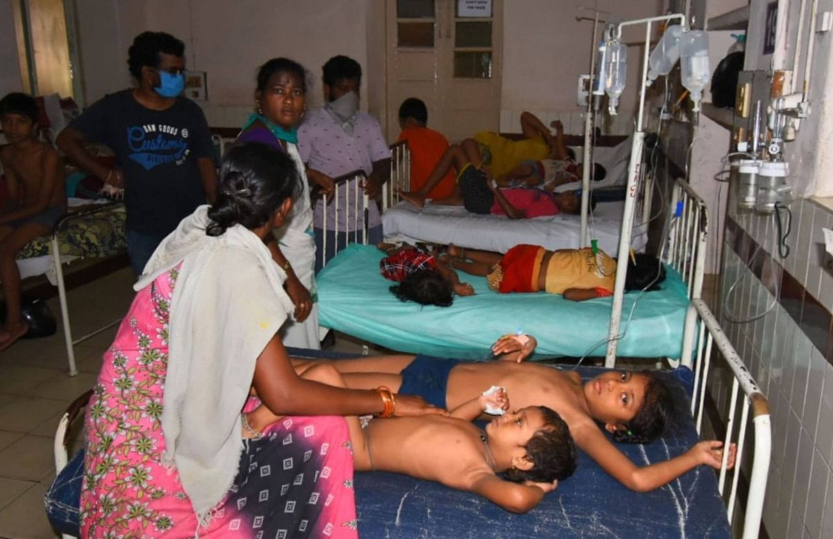Family members take their unconscious children to a hospital after a major chemical gas leakage at LG Polymers industry in RR Venkatapuram village.