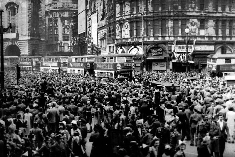 Crowds gathering in celebration at Piccadilly Circus, London during VE Day on 8 May 1945.