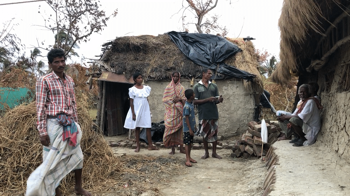 The Bhunia family, outside their house in the G-Plot island of Sunderbans.