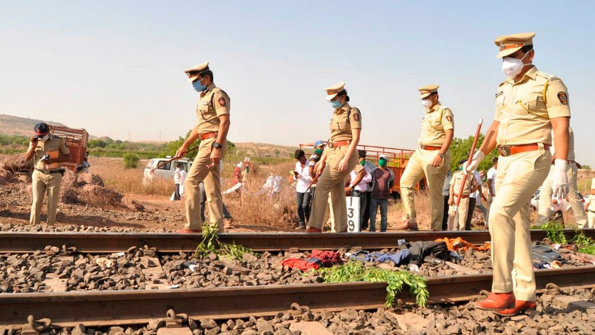 Police personnel inspect the spot after a goods train ran over a group of migrant workers while they were sleeping on the tracks, in Aurangabad.