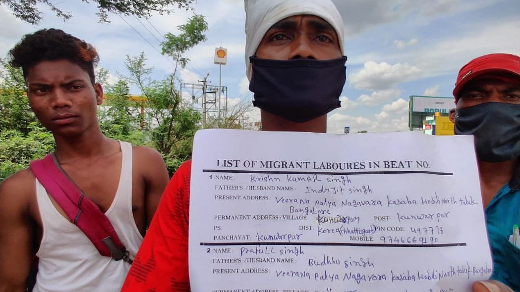 Krishan Kumar Singh, a migrant worker, showing his documents.