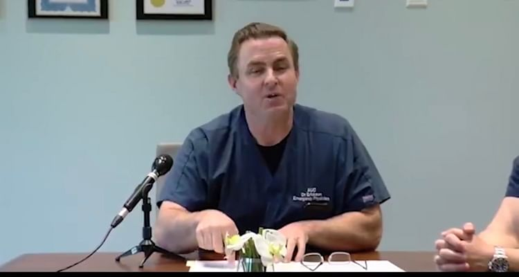 The video uses footage from a press conference by a Dr Erickson.