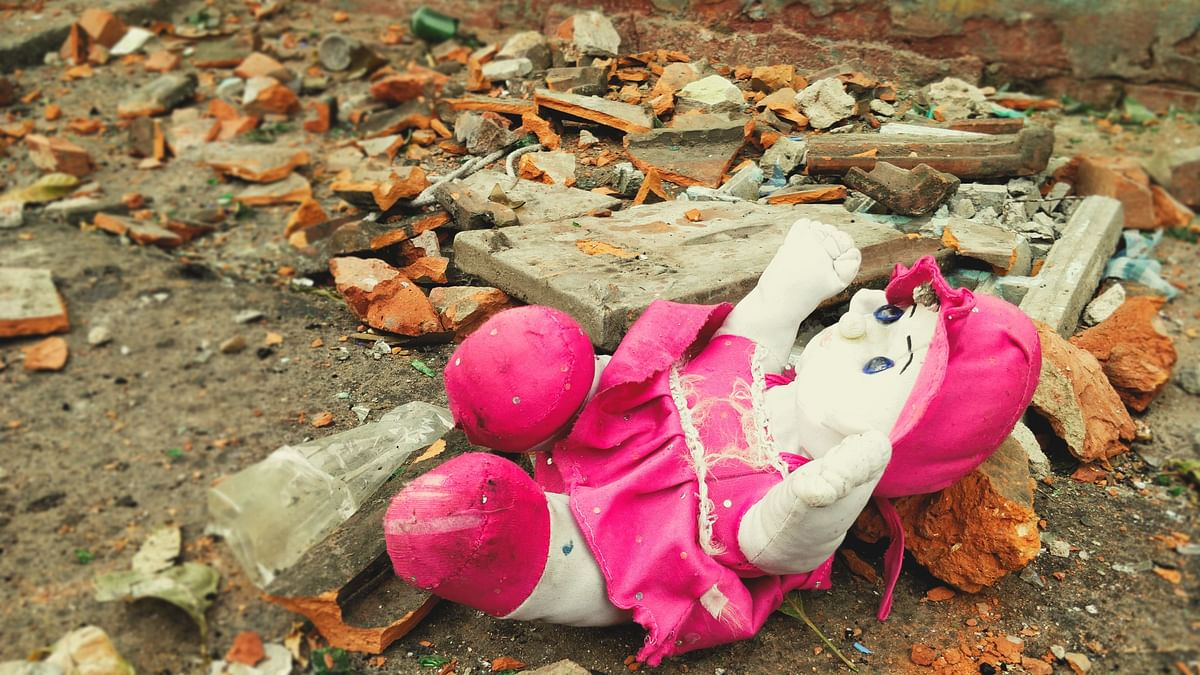 A forgotten doll lies amidst broken bricks and shards of glass at the site of violence in at a locality called Telinipara in West Bengal's Hooghly district.