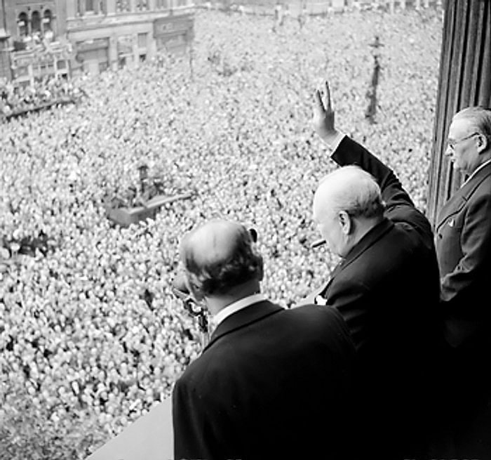 Winston Churchill waving to crowds in Whitehall on 8 May 1945, celebrating the end of the war.