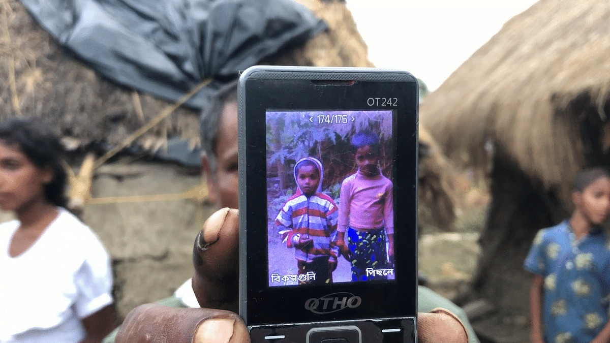 Pranab Kumar Bhunia shows Shibayan's photo (left) on his little handset.