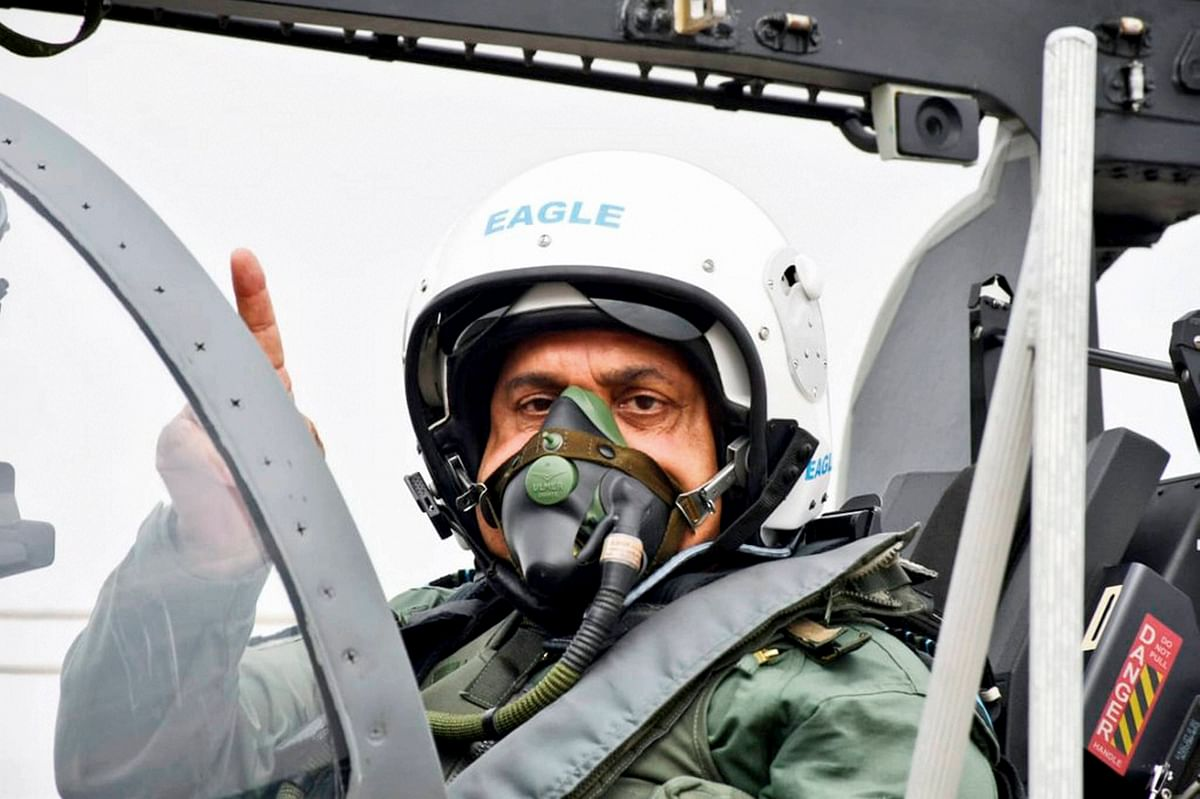 IAF chief RKS Bhadauria prepares to fly Tejas single-seater Light Combat Aircraft (LCA), during its induction ceremony on 27 May.