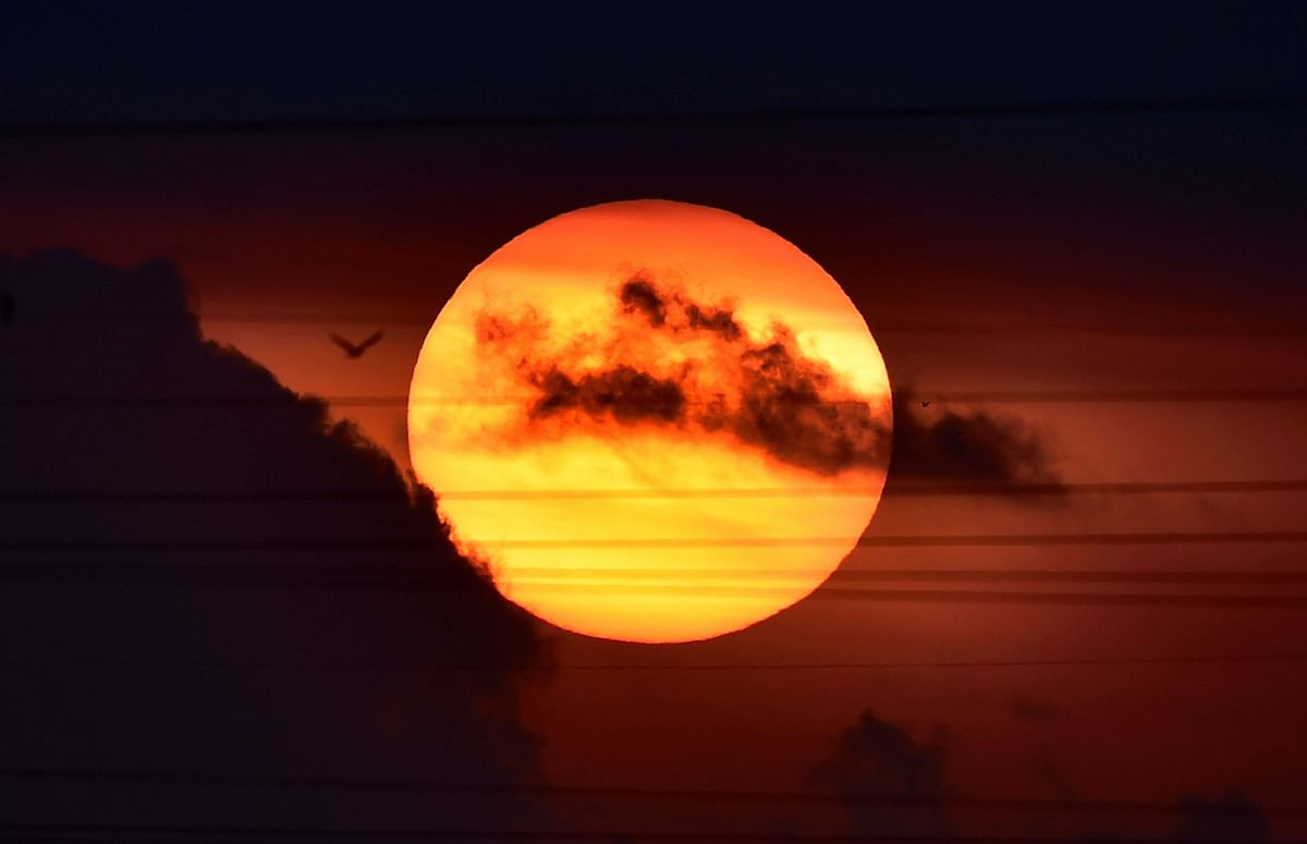 A view of sunrise over the sky near Pallikaranai, during the nationwide lockdown in Chennai, Friday.