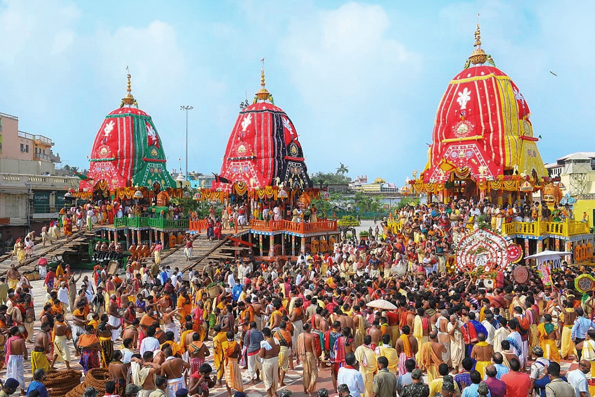 Priests and devotees take part in the pahandi rituals of Lord Jagannath Rath Yatra in Puri.
