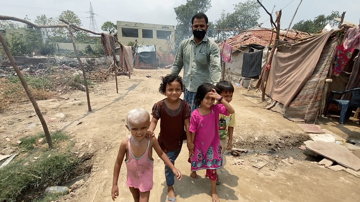 Abdullah and his children at the Kalindi Kunj camp in Delhi.
