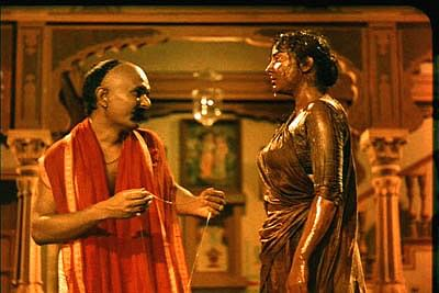 Kanhaiya Lal and Nargis in a scene from Mother India