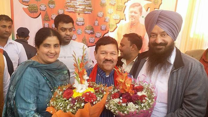 Delhi BJP Vice-President Kulwant Singh Baath with his wife Gurjeet Kaur, EDMC Councillor and senior BJP leader Shyam Jaju.