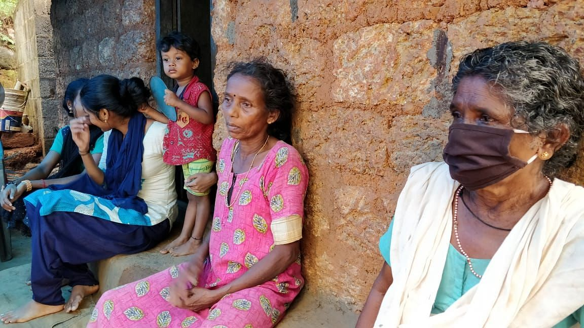Devika's mother (dressed in pink) is inconsolable after the death of her daughter.