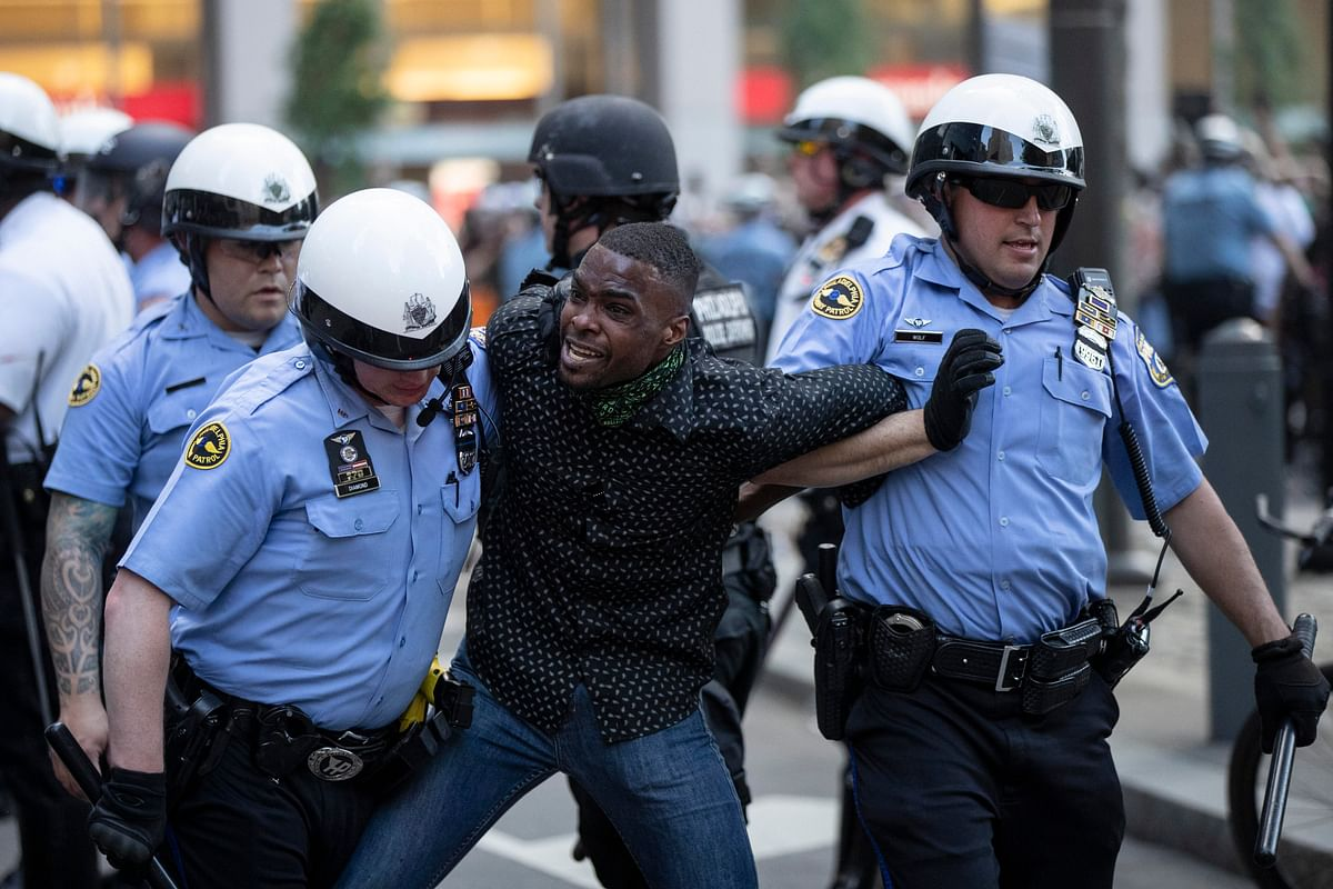 Philadelphia police restrain a man during the Justice for George Floyd Philadelphia Protest on Saturday, 30 May.