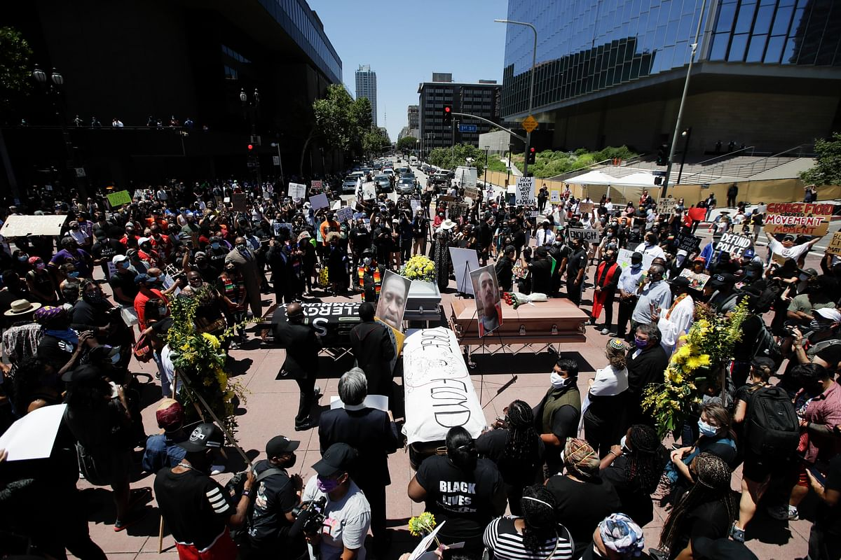 Caskets are laid out in the shape of a cross on Monday in Los Angeles during a protest over the death of George Floyd.