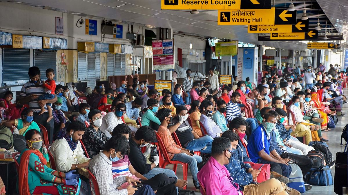 Passengers sit in the lounge area of Ranchi Railway station before boarding the Patna Jan Shatabdi Express, in Ranchi on Monday, 1 June.