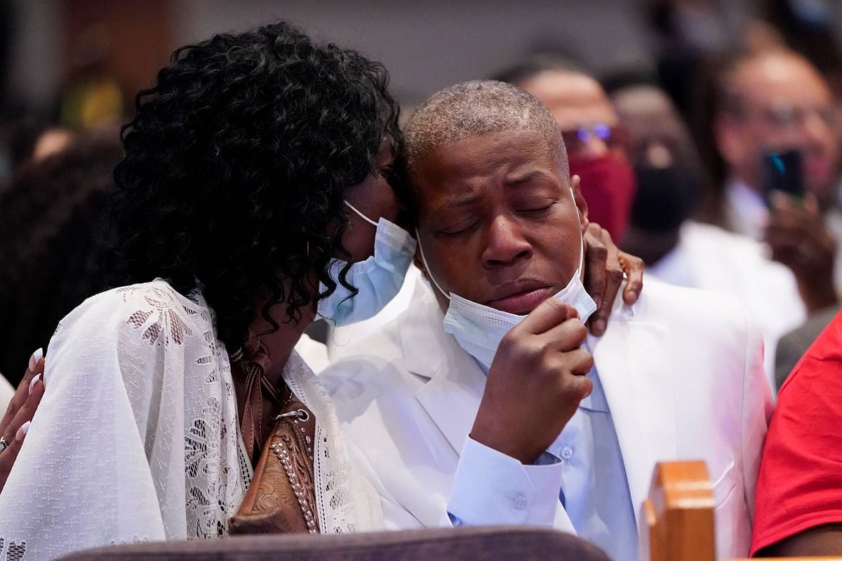 George Floyds sisters, Zsa Zsa Floyd and LaTonya Floyd, embrace during the funeral service for their brother.