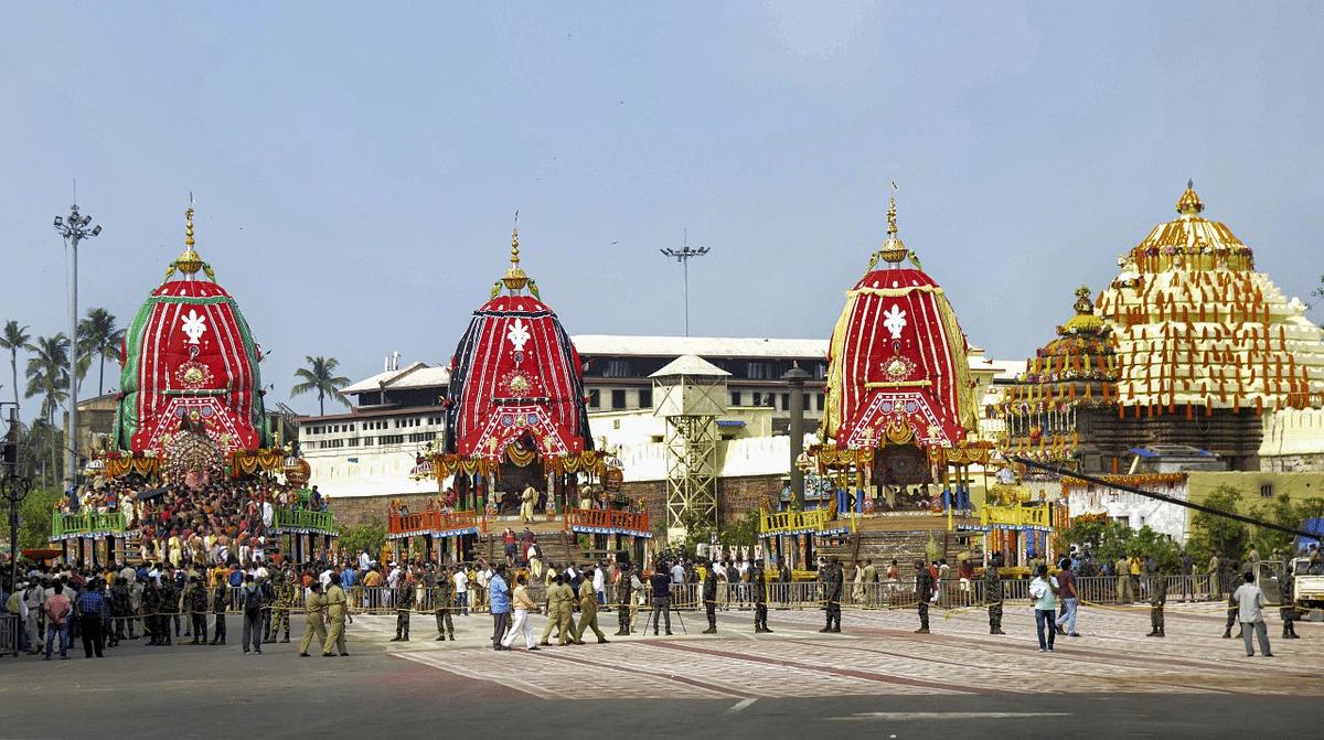 Devotees maintain social distancing while taking part in Lord Jagannath Rath Yatra at Bada Danda (the Grand Road) in Puri.
