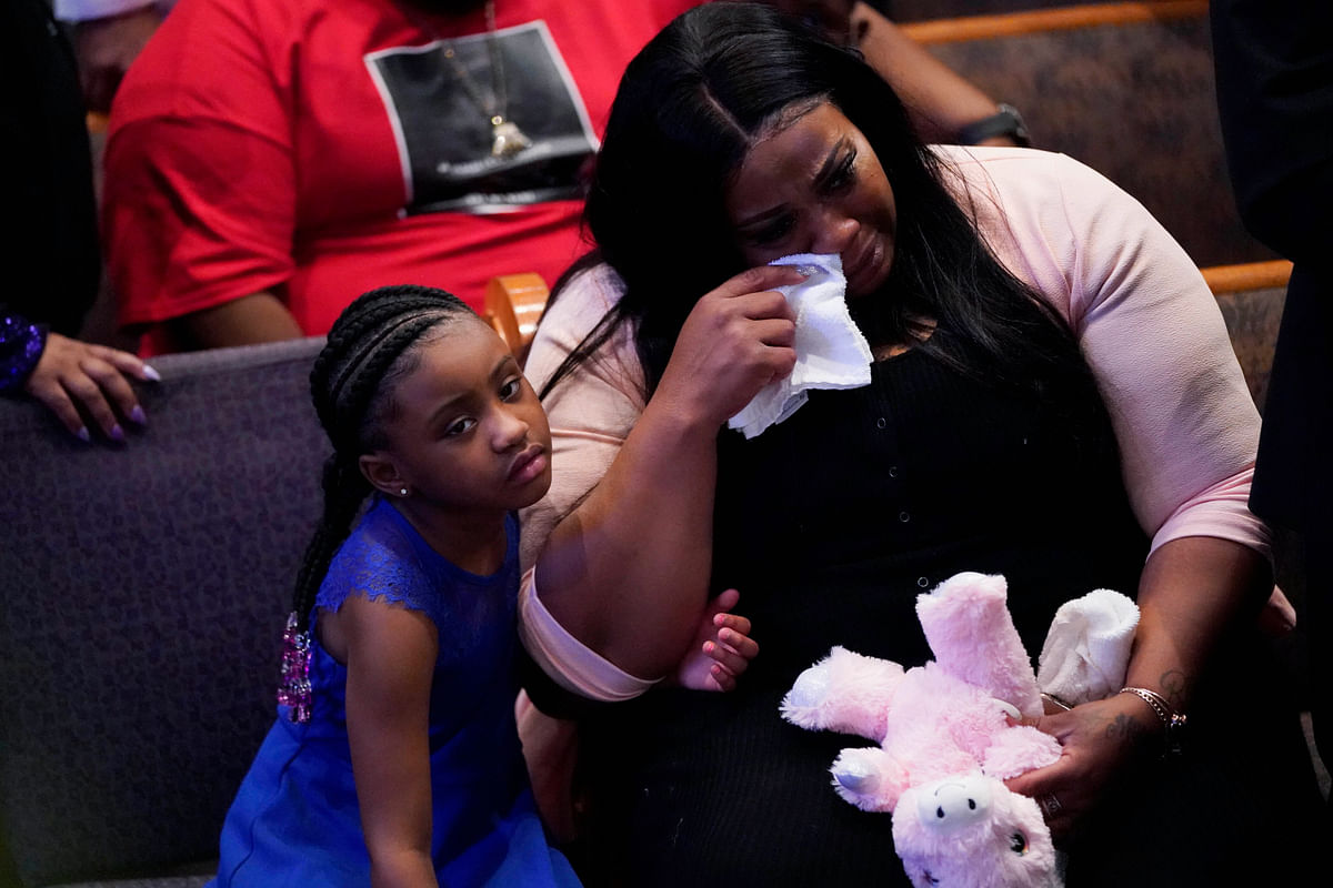 Roxie Washington weeps with Gianna Floyd, the daughter of George Floyd as they attend the funeral service for George Floyd at The Fountain of Praise church.