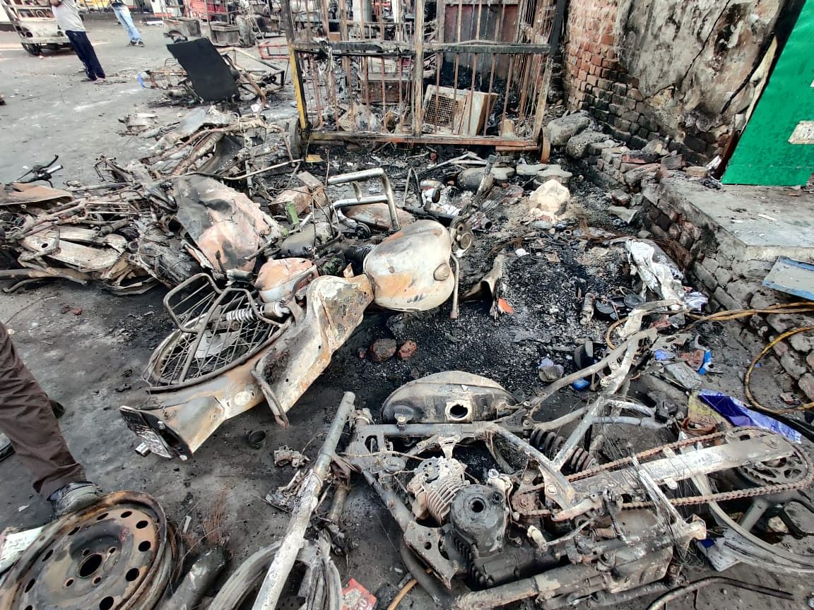 Bikes burnt outside the petrol pump in Chand Bagh area of Delhi.