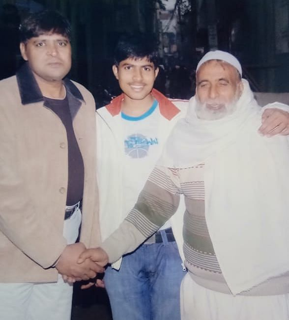 Parvez's father's (on the left) with members of his neighbourhood. His son Sahil says his father was working with two NGOs.