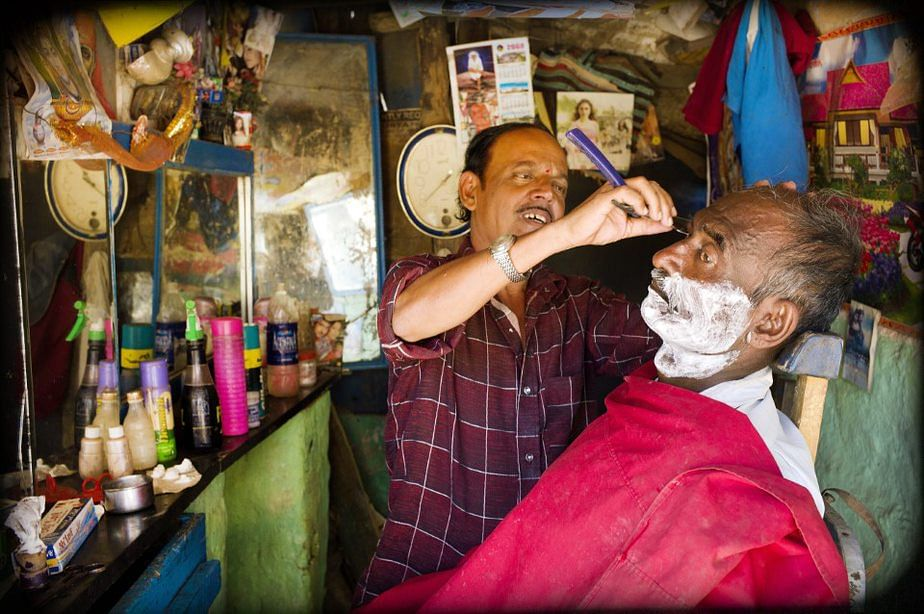 The neighbourhood barbershop also doubles as a hub where one can catch up on the latest happenings.