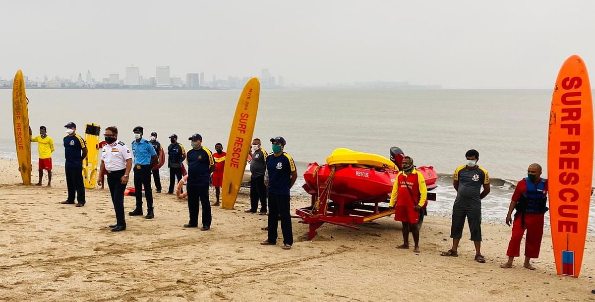Fire brigade personnel on standby along the beach.