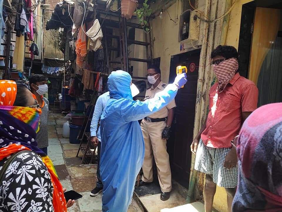 BMC officials going door to door screening residents.