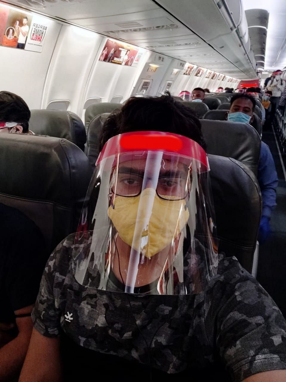 The airline gave us a surgical mask, face shield and a few sanitizer sachets.