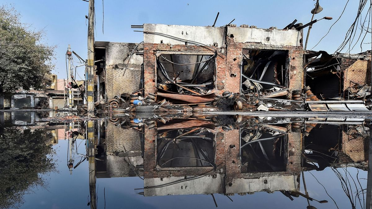 Charred remains of a vandalised property set ablaze by rioters in Gokulpuri area of the riot-affected north east Delhi, Wednesday, 26 February.