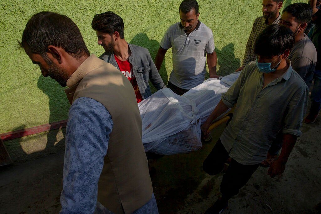 Relatives carry the body of Syed Omer Bari, brother of a politician Sheikh Wasim Bari, in Bandipora town, north of Srinagar, Thursday, July 9, 2020.