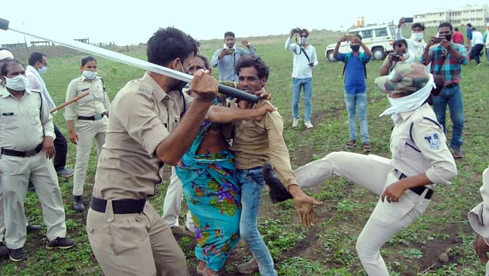 Policemen seen thrashing locals at the site of the incident.