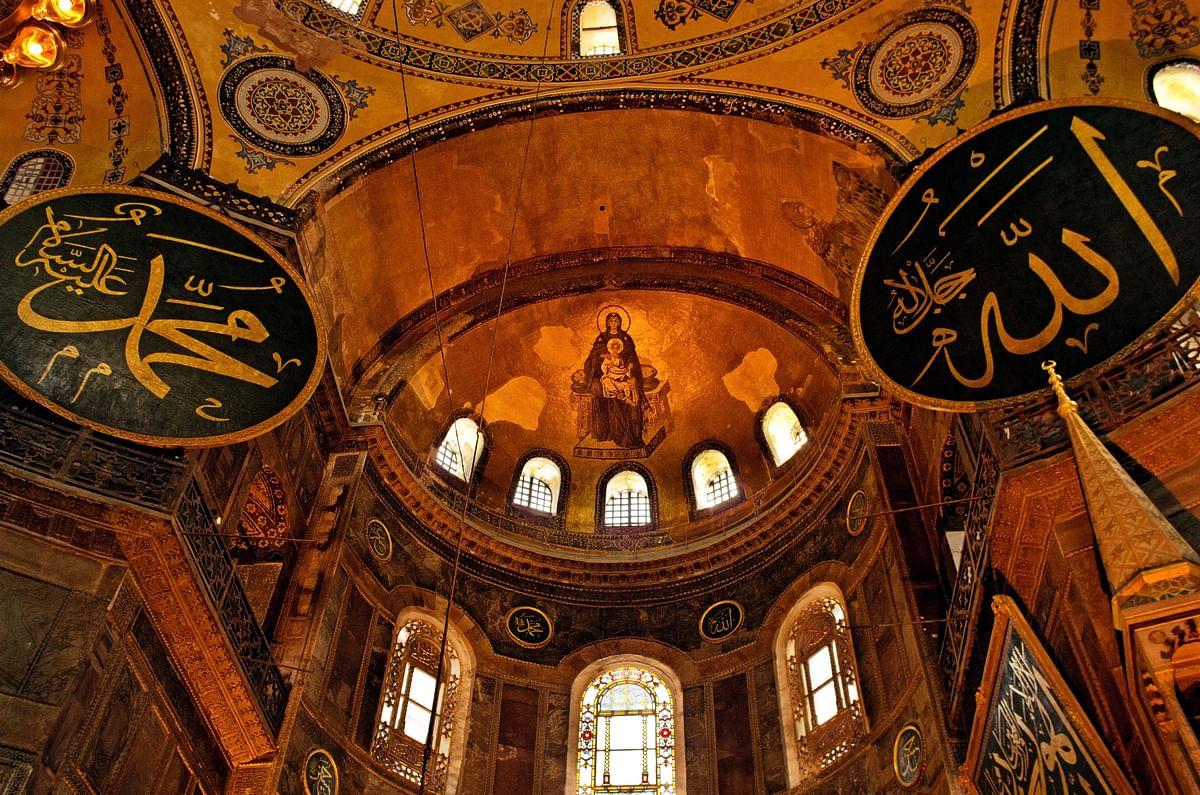 Symbols of both Islam and Christianity inside Hagia Sophia.