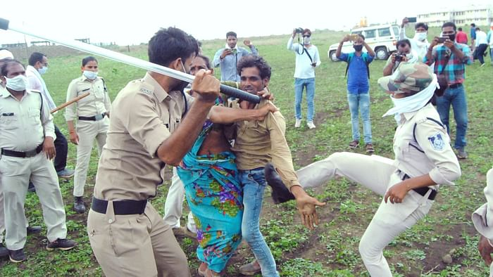 Policemen beating locals in Guna village after a couple consumed pesticide.
