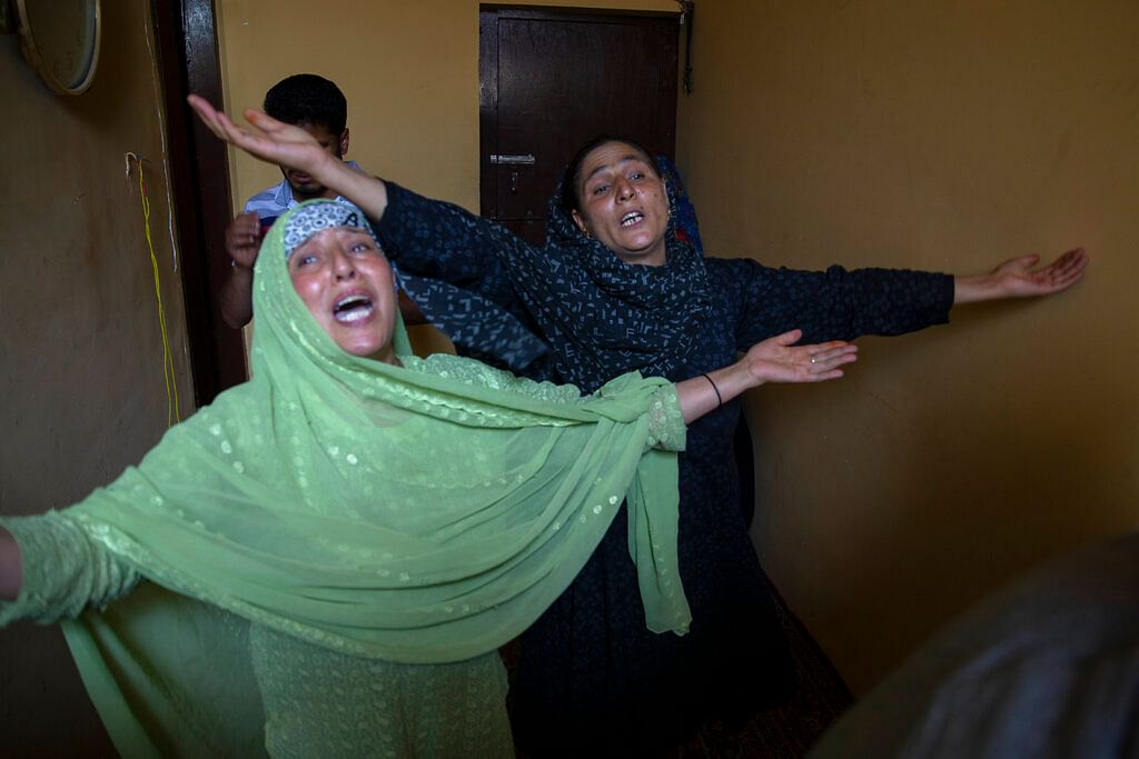 Relatives mourn during the joint funeral of a politician Sheikh Wasim Bari, his father and brother in Bandipora town, north of Srinagar, Thursday, July 9, 2020.